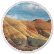 Painted Ridge And Sky Round Beach Towel by Greg Nyquist