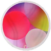 Round Beach Towel featuring the photograph Pastel Oil Bubble Water Drops by John Williams