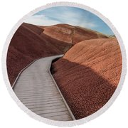 Pathway Through The Reds Round Beach Towel by Greg Nyquist