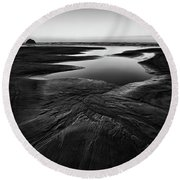 Round Beach Towel featuring the photograph Patterns In The Sand by Jon Glaser