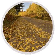 Round Beach Towel featuring the photograph Paved In Gold by Steve Stuller