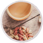 Peanut Butter Jar With Peanuts On Wooden Surface Round Beach Towel