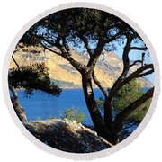 Peeping Through Pines Round Beach Towel