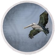 Round Beach Towel featuring the photograph Pelican Flight by Carolyn Marshall