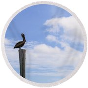 Pelican In The Clouds Round Beach Towel by Christopher L Thomley