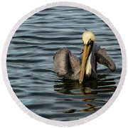 Round Beach Towel featuring the photograph Pelican Wing In A  Twist by Jean Noren