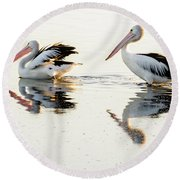 Pelicans At Dusk Round Beach Towel by Werner Padarin