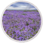 Phacelia Field And Clouds Round Beach Towel by Marc Crumpler