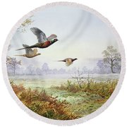 Pheasants In Flight  Round Beach Towel by Carl Donner