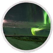 Photographer Under The Northern Light Round Beach Towel by Dubi Roman