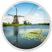 Round Beach Towel featuring the photograph Picturesque Kinderdijk by Hannes Cmarits
