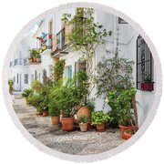 Picturesque Narrow Street Decorated With Plants Round Beach Towel