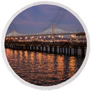 Pier 7 And Bay Bridge Lights At Sunset Round Beach Towel