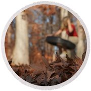 Round Beach Towel featuring the photograph Playing On The Tire Swing by Greg Collins
