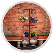Round Beach Towel featuring the photograph Potted Plants And A Brick Wall by James Eddy