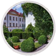 Round Beach Towel featuring the photograph Prague Courtyards. Regular Style Garden by Jenny Rainbow