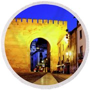 Round Beach Towel featuring the photograph Puerta De Elvira by Fabrizio Troiani