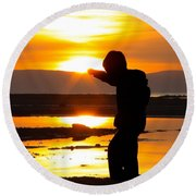 Punching The Sun Round Beach Towel