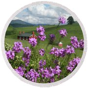 Purple Flower In Landscape Round Beach Towel by Emanuel Tanjala