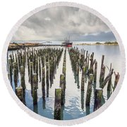 Round Beach Towel featuring the photograph Pylons To The Ship by Greg Nyquist