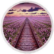Railway In A Purple Tulip Field Round Beach Towel