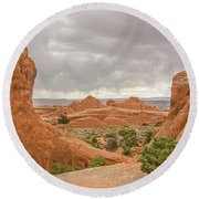 Round Beach Towel featuring the photograph Rain In The Distance At Arches by Sue Smith