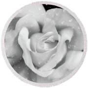 Round Beach Towel featuring the photograph Raindrops On Rose Black And White by Jennie Marie Schell