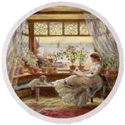 Reading By The Window Round Beach Towel