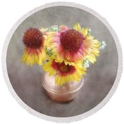 Round Beach Towel featuring the photograph Red And Yellow Gazanias In A Copper Pot by Louise Kumpf