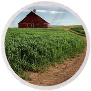 Red Barn In Green Field Round Beach Towel