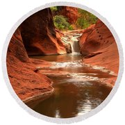Red Cliffs Waterfall Canyon Round Beach Towel