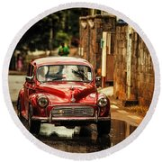 Red Retromobile. Morris Minor Round Beach Towel by Jenny Rainbow