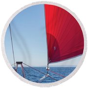 Round Beach Towel featuring the photograph Red Sail On A Catamaran by Clare Bambers