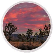 Red Sky Over Joshua Tree Round Beach Towel