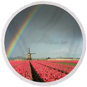 Round Beach Towel featuring the photograph Red Tulips, A Windmill And A Rainbow by IPics Photography