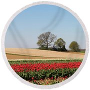 Red Tulips Landscape Round Beach Towel