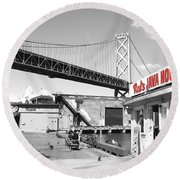 Round Beach Towel featuring the photograph Reds Java House And The Bay Bridge In San Francisco Embarcadero . Black And White And Red by Wingsdomain Art and Photography