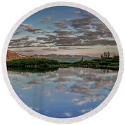 Round Beach Towel featuring the photograph Reflection In A Mountain Pond by Don Schwartz