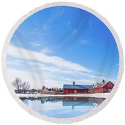Reflection Of A Barn In Winter Round Beach Towel