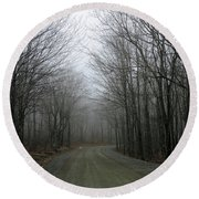 Ride In The Forest Round Beach Towel