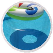 Ring In A Swimming Pool Round Beach Towel by Michael Canning