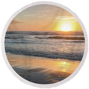 Rising Sun Reflecting On Wet Sand With Calm Ocean Waves In The B Round Beach Towel