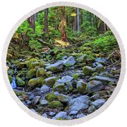 Riverbed Full Of Mossy Stones With Small Cascade Round Beach Towel
