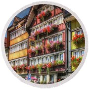 Round Beach Towel featuring the photograph Row Of Swiss Houses by Hanny Heim
