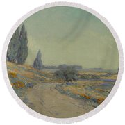 Road Through A Field Of Wildflowers Round Beach Towel