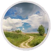 Road To The Sky Round Beach Towel