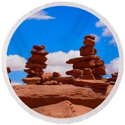 Round Beach Towel featuring the photograph Rock Cairns In The Desert by Dany Lison