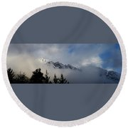 Rockies In The Clouds. Round Beach Towel