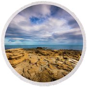 Round Beach Towel featuring the photograph Rocks And Clouds. by Gary Gillette
