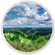 Rolling Hills And Puffy Clouds Round Beach Towel